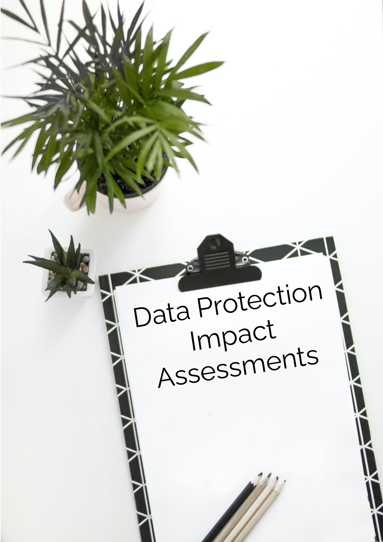 "Clipboard saying ""Data Protection Impact Assessments"""