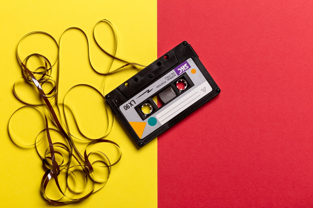 cassette tape on yellow and red background