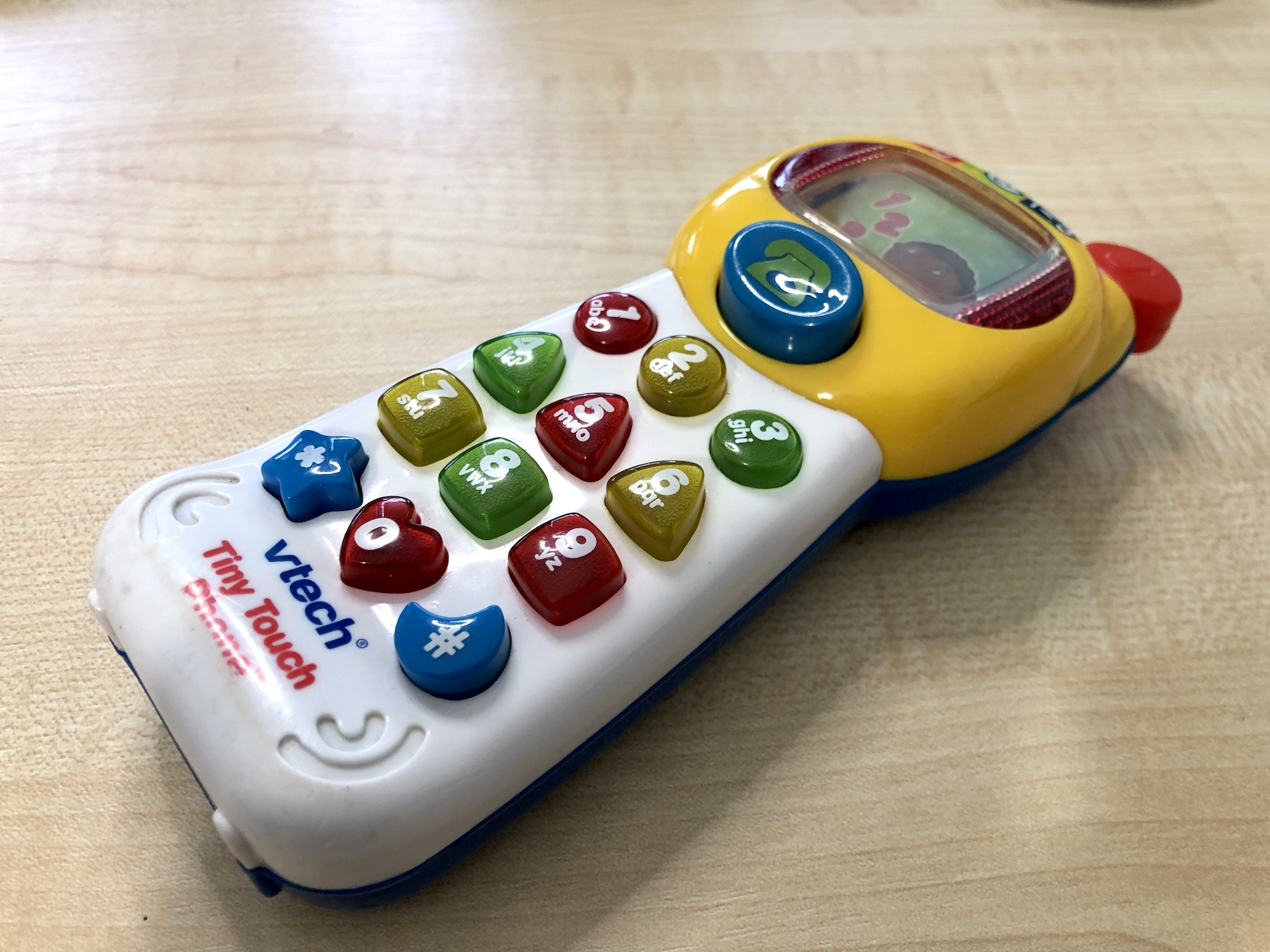 A child's phone lying on a desk